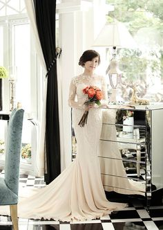 Couture Fit-n-Flare Long Sleeve Wedding Gown by ABridalCouture $900