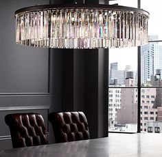 "RH's Rhys Clear Glass Prism Round Chandelier 43"":The Art Deco style born in 1920s Paris is evident in the straight-and-curved lines of our elegant chandelier. Its optical-quality prisms, arranged in even, concentric rings, hang in sparkling harmony from an iron frame clad in polished nickel."