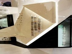 his Athens optical store presents a design-savvy way to display eyewear. Located in Neo Psyhiko, Athens, the boutique was designed by architect Simos Vamvakidis, who infused the interior with sharp, geometric displays and an overall minimalistic aesthetic.