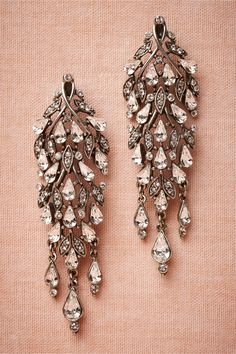"Cristallino Earrings: Brilliant Swarovski crystal droplets twine along antiqued silver vines, forming elegantly ornate chandeliers. Handmade by Ben-Amun. 2.75""L, 1""W. Hypoallergenic posts. Antique silver plate, pewter, Swarovski crystal. USA."