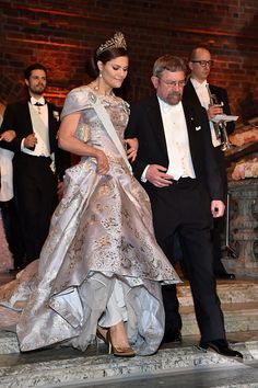 Crown Princess Victoria of Sweden and Professor J Michael Kosterlitz laureate of the Nobel Prize in Physics arrive at the Nobel Prize Banquet 2015 at...