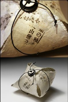 Handmade paper is formed into a basket and secured with a button. So little, so simple!