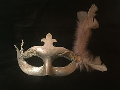 Silver and white masquerade mask. This took about 45 minutes to make