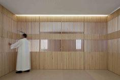 Wooden semi-transprant doors inside the Nossa Senhora das Necessidades Church by Celia Faria, Ines Cortesao.