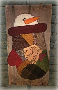 Hadley James is a snowman peeking out from a crazy quilted mitten made from scraps of recycled wool and embellished with Warm Winter Welcome and embroidery. He is mounted on a piece of rustic and weathered barn wood. Christmas Sewing, Primitive Christmas, Felt Christmas, Christmas Snowman, Christmas Ornaments, Snowman Crafts, Christmas Projects, Felt Crafts, Holiday Crafts