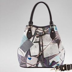 Stationery Printed  Barrel Handbag  This bag is made of PU leather material can be used as a handbag, shoulder bag or a messenger bag. It carries 5 pockets and comes in printing color.