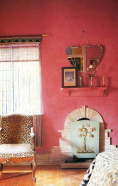 Pink walls and leopard unholstered louis chair.  Love the mirror too.