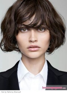 thick bangs + wavy bob | maybe this could work. possible that my hair is too thick for this and I would have triangle head.