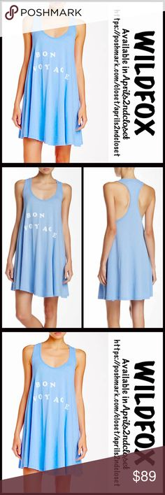 "❗️1-HOUR SALE❗️WILDFOX TANK DRESS Bon Voyage Mini WILDFOX TANK DRESS Coverup Bon Voyage Mini 💟 NEW WITH TAGS 💟 RETAIL: $98  * A relaxed fit & oversized A-line silhouette  * Incredibly soft & comfortable  * Graphic detail on front; A texture that is purposely subtly distressed. * About 36"" long   * A scoop neckline & tank straps, semi backless  Fabric: 100% Cotton; Machine wash, Made in the USA Color: Tai Blue Item: WF #  Pastel # Shirt dress 🚫 No Trades/PAYPAL🚫 ✅ Offers Considered*✅ ✅…"