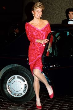 Diana wore this off-the-shoulder hot pink dress to an event at the Barbican in 1990.