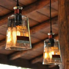 I would take off the label but cook idea. Recycled 1800 Tequila Bottle Pendant Lamp with old fashioned light bulb Diy Bottle Lamp, Bottle Art, Bottle Crafts, Bottle Chandelier, Chandelier Ideas, Tequila Bottles, Liquor Bottles, Glass Bottles, Empty Bottles