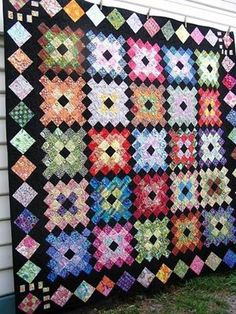 Granny square quilt. Very old-fashioned looking.  Would make a good memory quilt using scraps from other quilts.