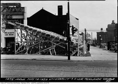 University Avenue bleachers for visit of King George VI in 1939 Toronto. Note the 10 minute car wash sign on the left. 10 Minutes! Now that's thorough!