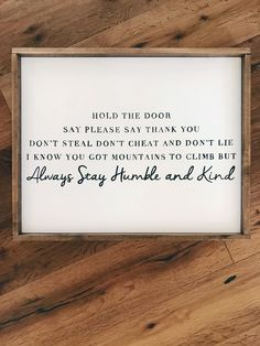 """This unique, handpainted white script wooden sign is on a white painted piece of wood with a light brown-stained frame. Dimensions: 17"""" x 21"""" This sign is handmade upon ordering from one of our wonderful signmakers. Please allow 3-4 weeks for delivery. Thank you!"""