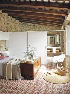 Master bedroom suite in a home in Girona, Spain designed by Glòria Duran Torrellas