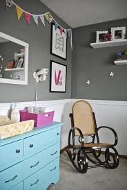 Whimsical-Nursery - love the blue dresser against the grey and white.
