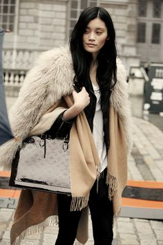 camel and black always a classic. love the chic layers