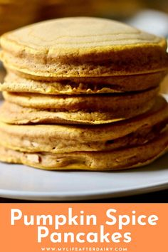 These fluffy pumpkin spice pancakes are a perfect dairy free fall breakfast recipe. They are quick and easy to make and packed with pumpkin, pumpkin spice, and cinnamon flavors. They are a great make ahead breakfast because you can make and freeze them and reheat when you are ready to eat them again. They are filling and delicious. #pumpkinspice #pancakes #pumpkin #dairyfree
