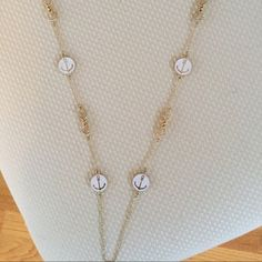 Gold Long Anchor Necklace Worn once in perfect condition, white and gold anchor necklace. Jewelry Necklaces