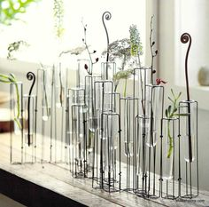 Presenting a symphony of glass, making beautiful music with the visual syncopation of the Arpeggio Vase. Delicate iron wire with brass brazing forms a jointed frame which moves to transform into a myr