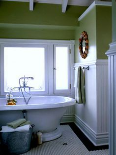 Still obsessing about free standing tubs. Nice job, with the towels in the galvenized bucket. Adds charm.