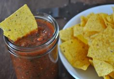 Easy Blender Salsa  Ingredients:  1- 14 oz can diced tomatoes  1- 10 oz can orginal Rotel  1/2 sm onion, roughly chopped  1 clove garlic, peeled & smashed  1/2-1 jalapeno, seeded or not (depends on how spicy you like it)  1 tspn honey  1/2 tspn salt  1/4 tspn ground cumin  small to medium size handful of cilantro, washed  juice of 1 lime    Directions:  Put everything in food processor & pulse to combine until salsa is desired consistency. Adjust seasoning to taste.