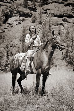 Mounted Warrior with a Rifle - Cherokee Native American Indian in traditional costume against rock cliffs in western Wyoming. Native American Horses, Native American Warrior, Native American Pictures, Native American Beauty, American Indian Art, Native American History, American Symbols, American Women, Native Indian