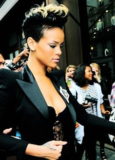 Rihanna hair style -  every time I want to grow my hair I find a cute picture of this hairstyle.  No stylist will do it for me.  I may just have to do it myself.