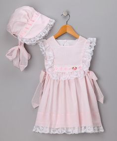 Take a look at this Pink Dobby Dress & Bonnet - Toddler by C.I. Castro & Jayne Copeland on #zulily today!
