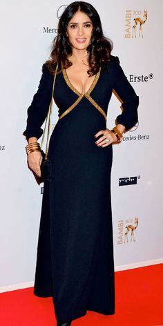 Hayek Pinault attended the Bambi Awards in Germany clad in a gold trimmed Saint Laurent gown and matching accessories.