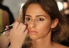 Tribal Makeup Inspiration: More white! The dots across the nose and cheekbone are small but create a more authentic tribal feel.