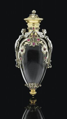 A FRENCH TWO-COLOUR GOLD AND GEM-SET ROCK-CRYSTAL PERFUME BOTTLE - CIRCA 1870