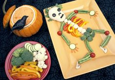 Eat your veggies! Create some neat food art with this tutorial that walks you through how to do a skeleton veggie spread!