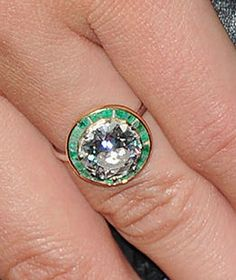 TOTALLY OBSESSED. Olivia Wilde's ring. round with emeralds.