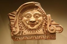 An Etruscan Terracotta Fragmentary Roof Ornament with Medusa, with Extensive Remains of Polychromy. Terracotta and polychromy, 550-500 B.C.E