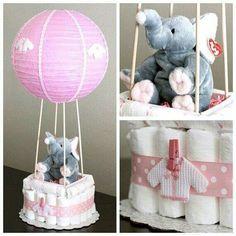 Diaper cake hot air balloon as centerpiece.