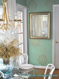 Love the delicate gold stencil and seafoam green wall.