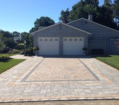 @cambridgepavers driveway with integrated walkway and stoop. Designed and installed by Above All Masonry.