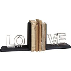 Add a focal point to your bookcase or study desk with this set of bookends. Showcasing a wire 'LOVE' design, it adds a charming touch to your rustic or count...