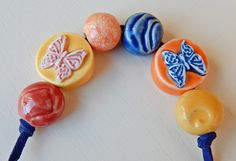 "Set beads porcelain "" butterflies "" By Mª Carmen Rodriguez https://www.facebook.com/groups/CeramicArtBeadMarket"