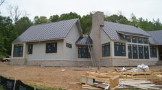 Another amazing Castle Home taking shape! This country home sits on about 1000 acres and is styled for a contemporary farmhouse with a 26' open beam vaulted family/kitchen gathering area around an oversized tiled fireplace. The metal roof was selected for the clean lines and low maintenance. It is a heavy 24 gauge with an extended 45 year warranty on the color.