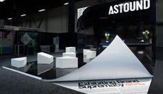 Astound Group in LA's booth in Las Vegas. Turn The Page in Your Exhibit Thinking, was also the overall theme of the booth. The high gloss, black laminate, art installation, displayed a page suspended in animation that was literally turning before your eyes.