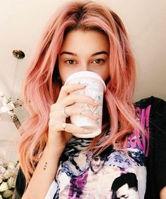 Hailey nearly broke the internet when she posted this Insta of her peachy-pink hair. We've seen pink hair before, sure, but Hailey's dark roots made the hue look cooler than ever before.
