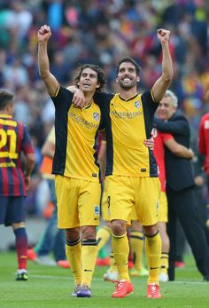 Raul Garcia and Tiago of Club Atletico de Madrid celebrate winning the La Liga after the match between FC Barcelona and Club Atletico de Madrid at Camp Nou on May 17, 2014 in Barcelona, Catalonia.