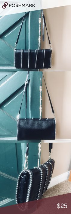 "Stylish black leather crossbody bag w metal decor Very stylish!  Soft great quality leather  Preloved, in like new condition  Size: 15"" x 7""  One of my favorite handbags in my closet!  Great both for going out in the evening and every day use! 💃💃💃 Bags Crossbody Bags"
