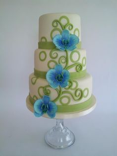 Blue and green wedding cake idea - three-tier wedding cake with blue orchid + piped green design {@caketopiacakes}