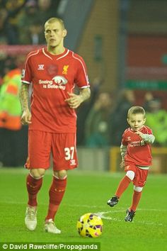 Skrtel's son kicks a ball on the Anfield pitch