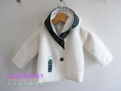 winter jacket with fabric detail around hood and matching buttons. *swoon*