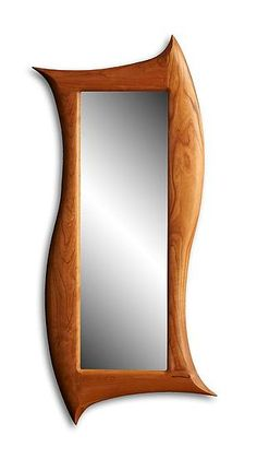Sensuous curves and undulating lines define this striking mirror. Crafted in solid wood, the frame will develop a rich patina over time, adding to its warmth and character. Finished mirror smooth, it is satisfying both to the eye and to the touch. This mirror is very flexible and can be hung in a variety of positions due to the four cleats on the back. Try it horizontal, vertical or slanted. $840.00