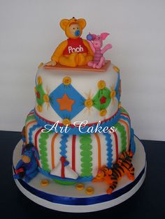 This, but without the characters. Put a baby elephant or monkey on top instead. Baby Shower Cake